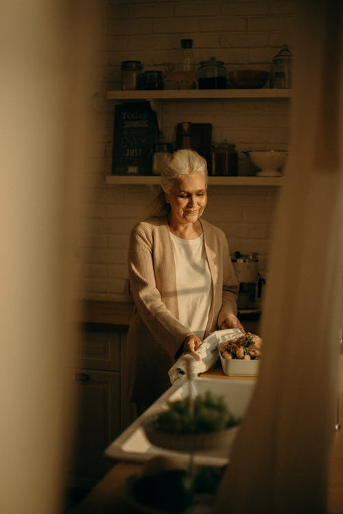 Old woman in a kitchen