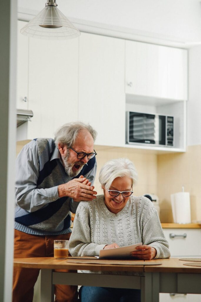 Old man and woman laughing