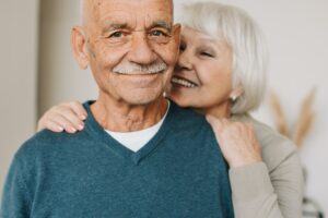 happy elderly man woman